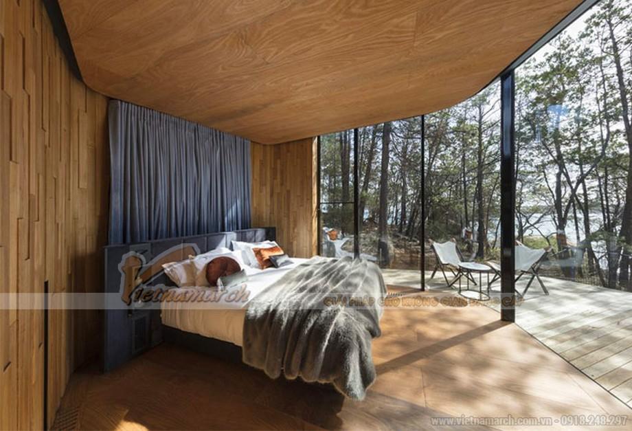 thiết kế phòng ngủ với tường ốp gỗ